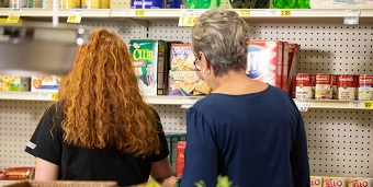 Two women looking for items in a store